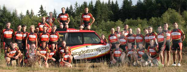 Pictured: Bicycleattorney.com cycling team with their team truck in 2008 - new jerseys with Hop Works and Bike n' Hike / Giant sponsor logos in addition to the Bicycleattorney.com logo.