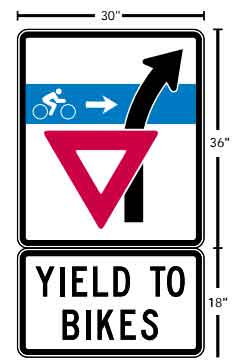 This was a road sign for Entrance ramps instructing motorists to yield to cyclists as they turn their car right to enter roadway such as an offramp from an interstate highway.