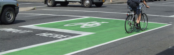 Portland bicycle lane and green bike box indicating a dangerous intersection.