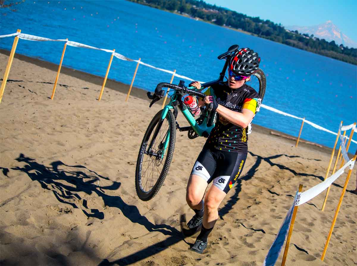 Pacific NW bicycle racing official Oregon one CX racer runs over obstacle while another bunny hops the barriers
